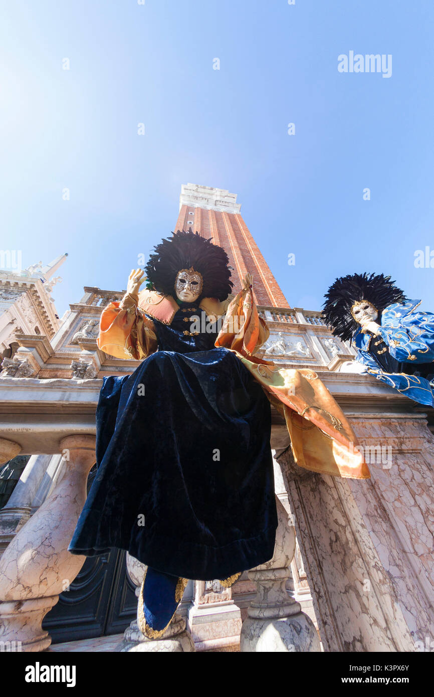 Colorful masks and costumes of Carnival of Venice famous festival worldwide Veneto Italy Europe - Stock Image