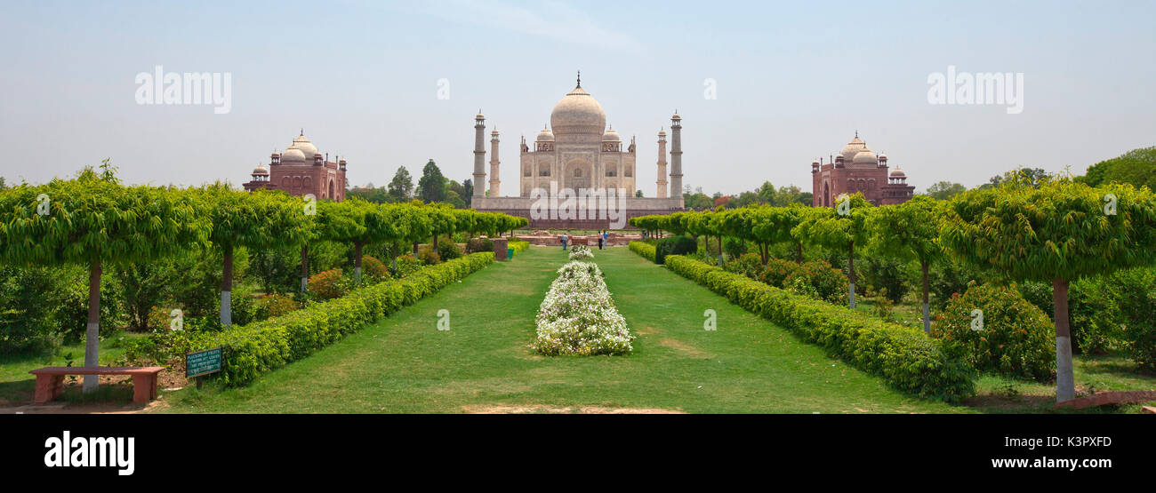 The Taj Mahal is located on the right bank of the Yamuna River in a vast Mughal garden that encompasses nearly 17 hectares, in the Agra District in Uttar Pradesh. It was built by Mughal Emperor Shah Jahan in memory of his wife Mumtaz Mahal Agra, India - Stock Image