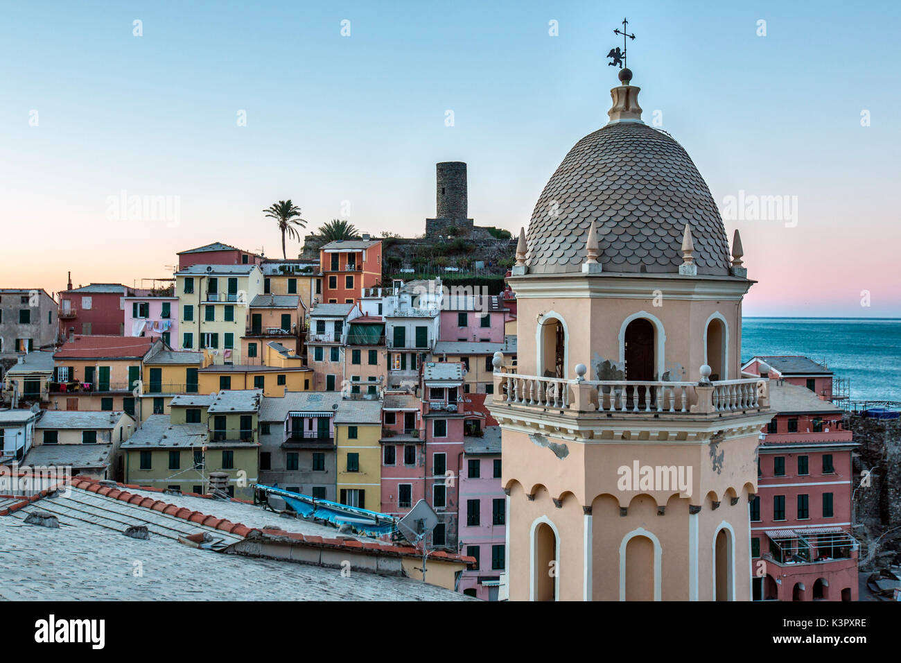 A detail of the church of Vernazza, one of the prettiest village of the Cinque Terre. In the background, pastel-colored houses overlooking the little natural harbor make Vernazza simply enchanting - Cinque Terre National ParK, Liguria, Italy Europe - Stock Image