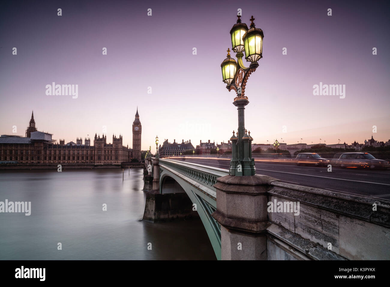 Old street lamp frames Westminster Bridge with Big Ben and Westminster Palace in the background London United Kingdom - Stock Image