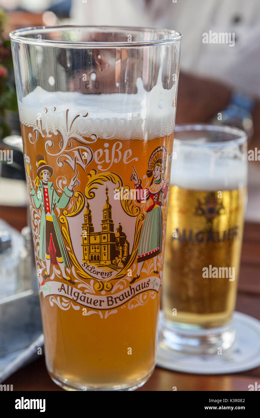 Details of decorated glasses of beer the typical German drink Garmisch Partenkirchen Oberbayern region Bavaria Germany Europe - Stock Image