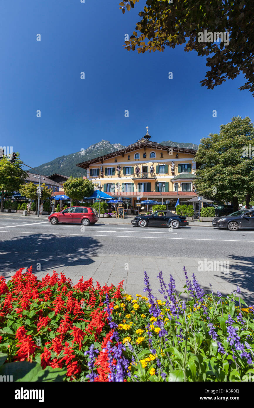 The typical hotels surrounded by peaks and colorful flowers Garmisch Partenkirchen Oberbayern region Bavaria Germany Europe - Stock Image