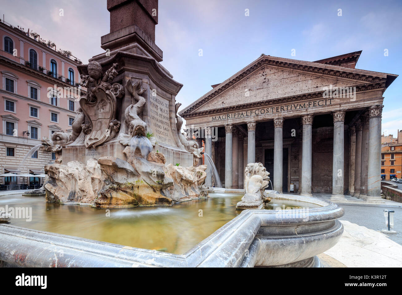View of old Pantheon a circular building with a portico of granite Corinthian columns and its fountains Rome Lazio Italy Europe - Stock Image
