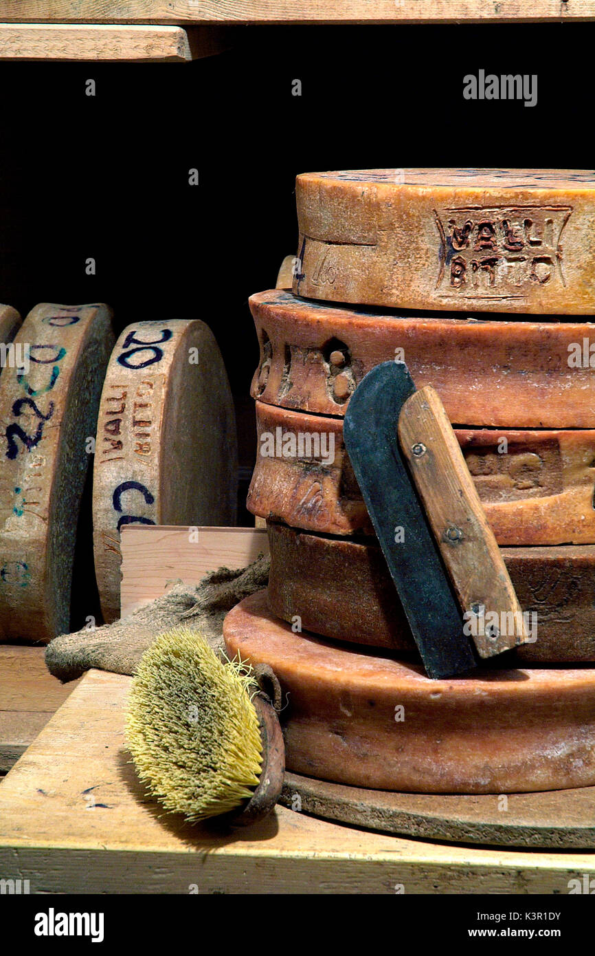 Old tools used to clean the Bitto cheese in a cellar in Val Gerola, Valtellina, Lombardy Italy Europe - Stock Image