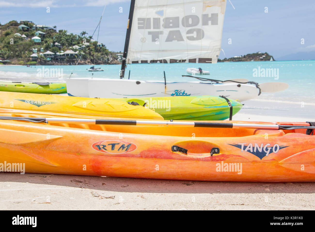 The resort on the Caribbean Sea and the boats for tourists Jolly Beach Antigua and Barbuda Leeward Island West Indies - Stock Image