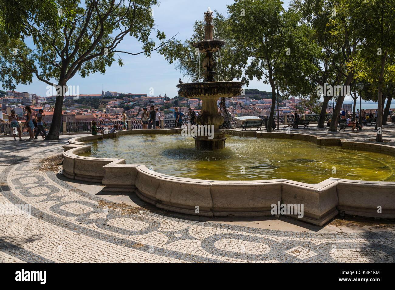 Fountain and square with decorative tiles on a terrace at Mirador de San Pedro de Alcántara Bairro Alto Lisbon Portugal Europe - Stock Image