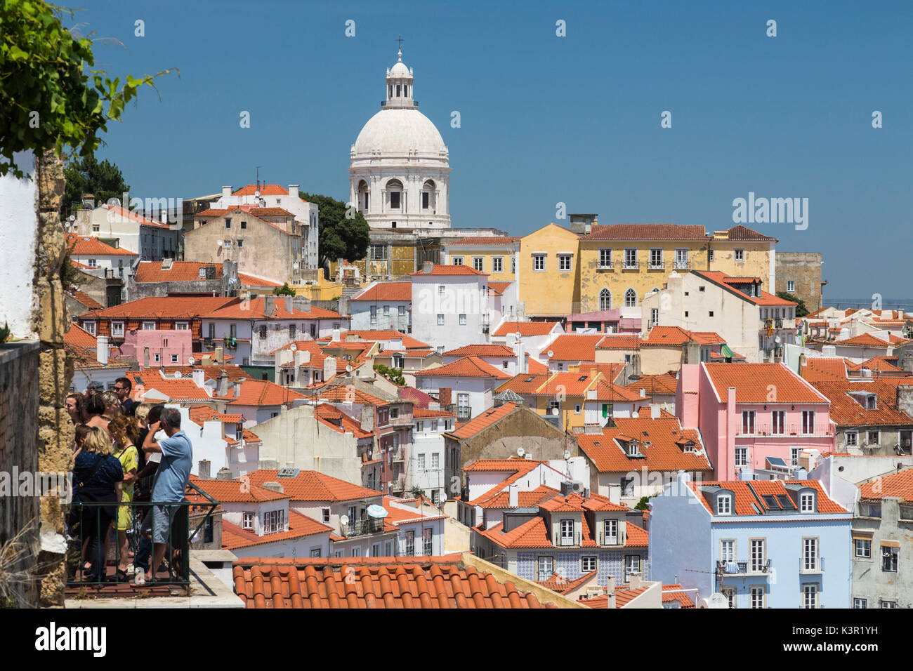 Terracotta roofs and the ancient dome seen from Miradouro Alfama one of the many viewpoints of Lisbon Portugal Europe - Stock Image