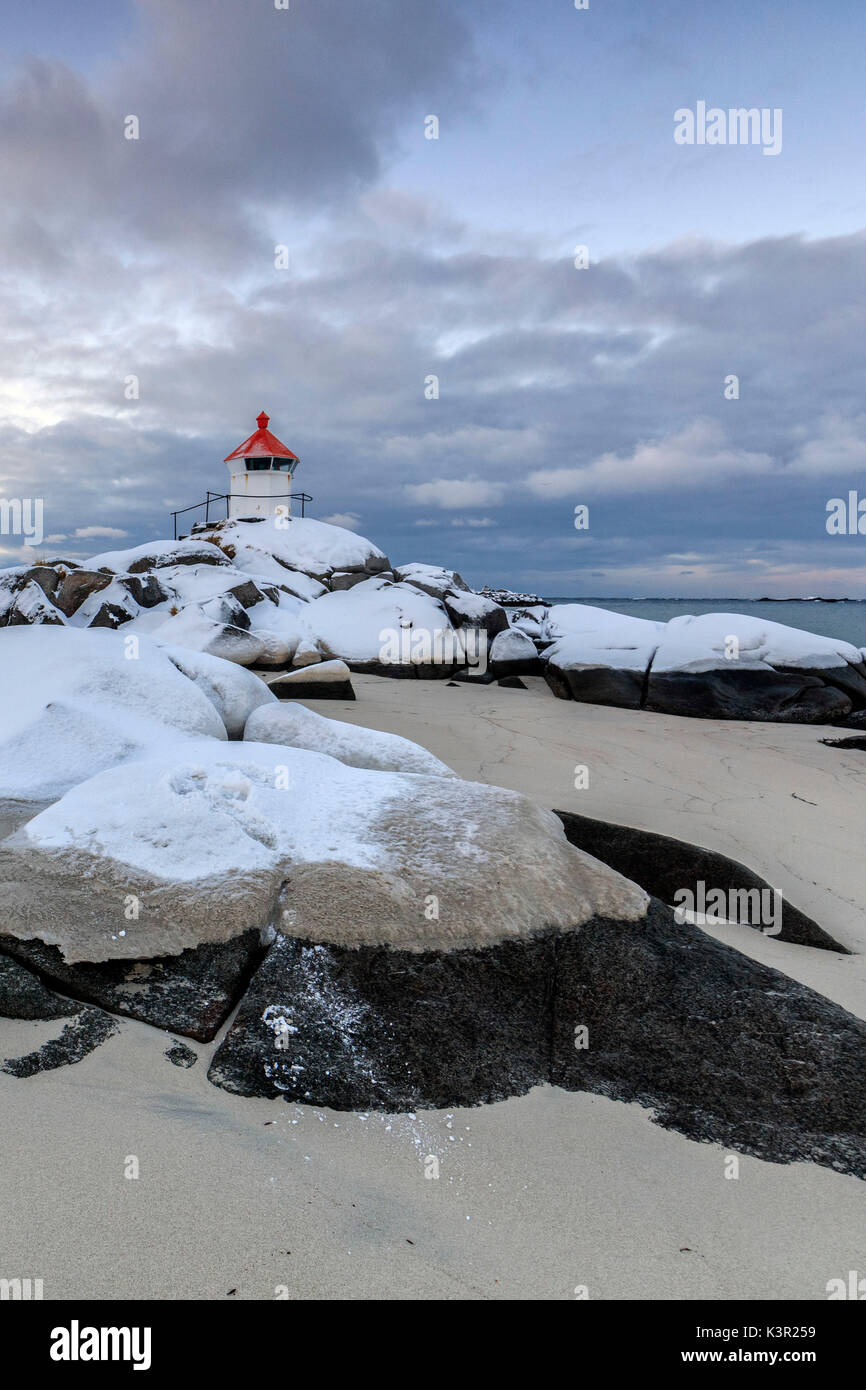 The blue arctic dusk on the lighthouse surrounded by snow and icy sand Eggum Vestvagoy Island Lofoten Islands Norway Europe - Stock Image