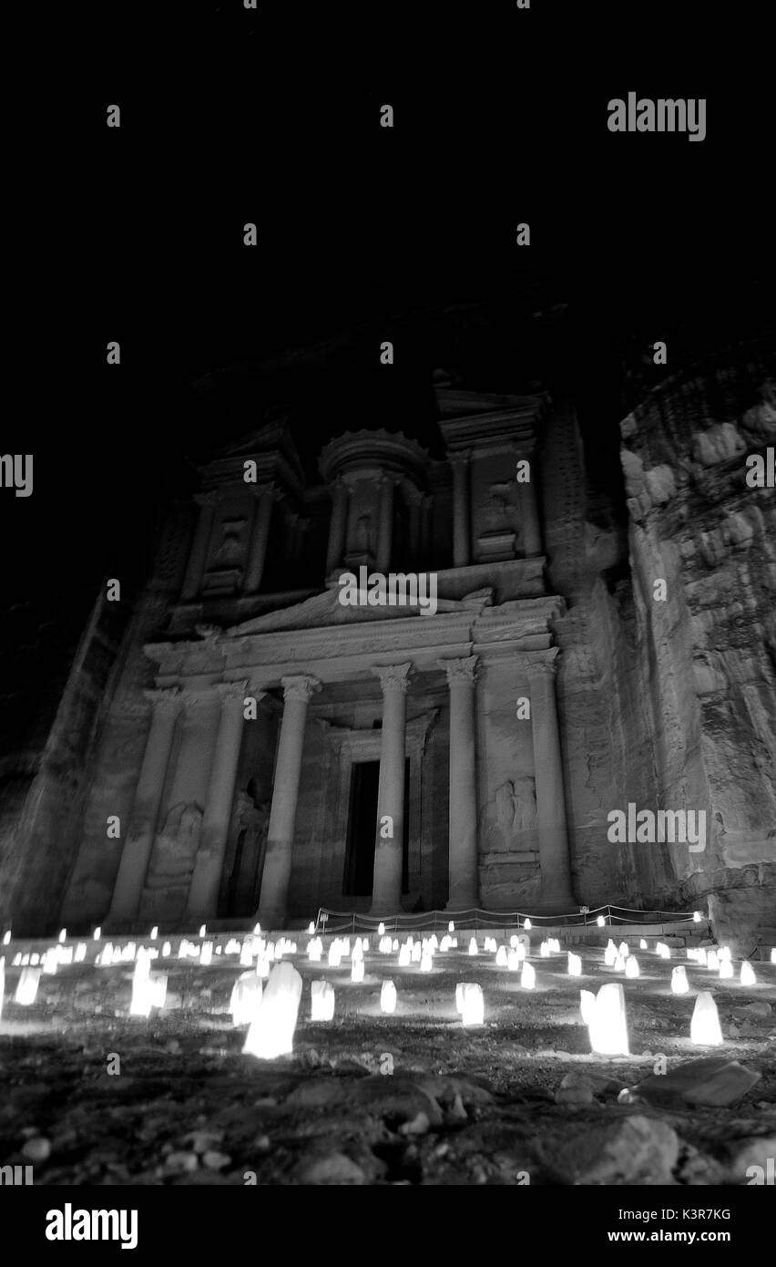 The magic of the Treasury of Petra by night, lit by candles that shed light into the darkness of the desert. - Stock Image