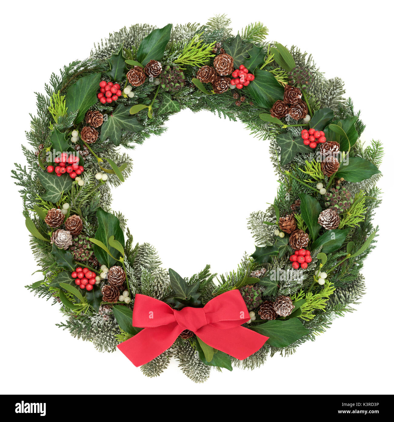 Christmas Wreath Decoration With A Red Bow Holly Mistletoe Snow Covered Juniper Fir