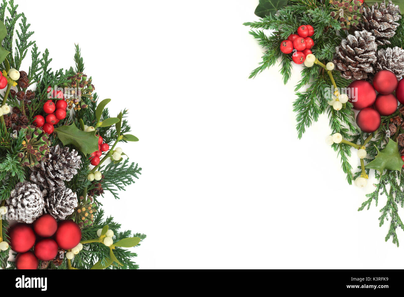 fca5d72d7ea2 Christmas decorative border with red bauble decorations, holly, ivy,  mistletoe, cedar and juniper leaf sprigs and pine cones on white background.