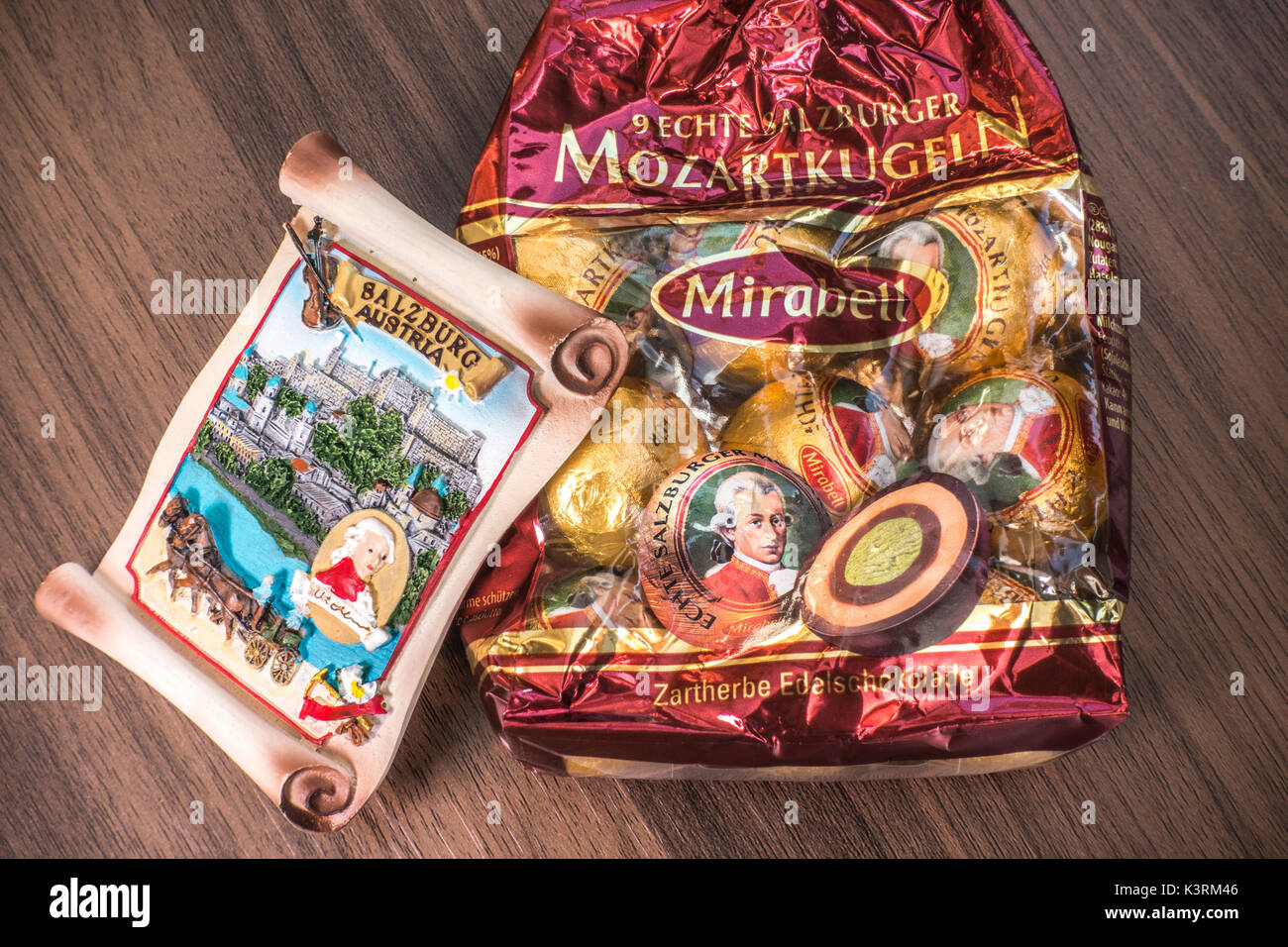 A Salzburg souvenir alongside a pack of Mirabell Mozartkugen Mozart chocolate balls - produced in the spirit of the original recipe in Salzburg. - Stock Image