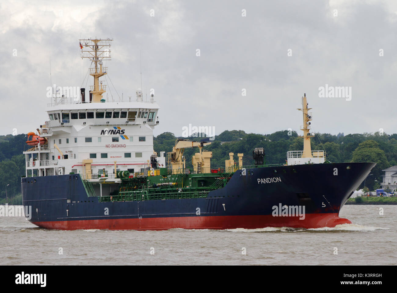 The tanker Pandion enters the Port of Hamburg. - Stock Image