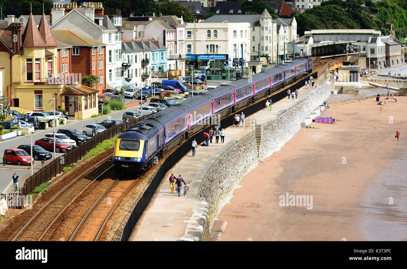 A high speed train passing through Dawlish. - Stock Image