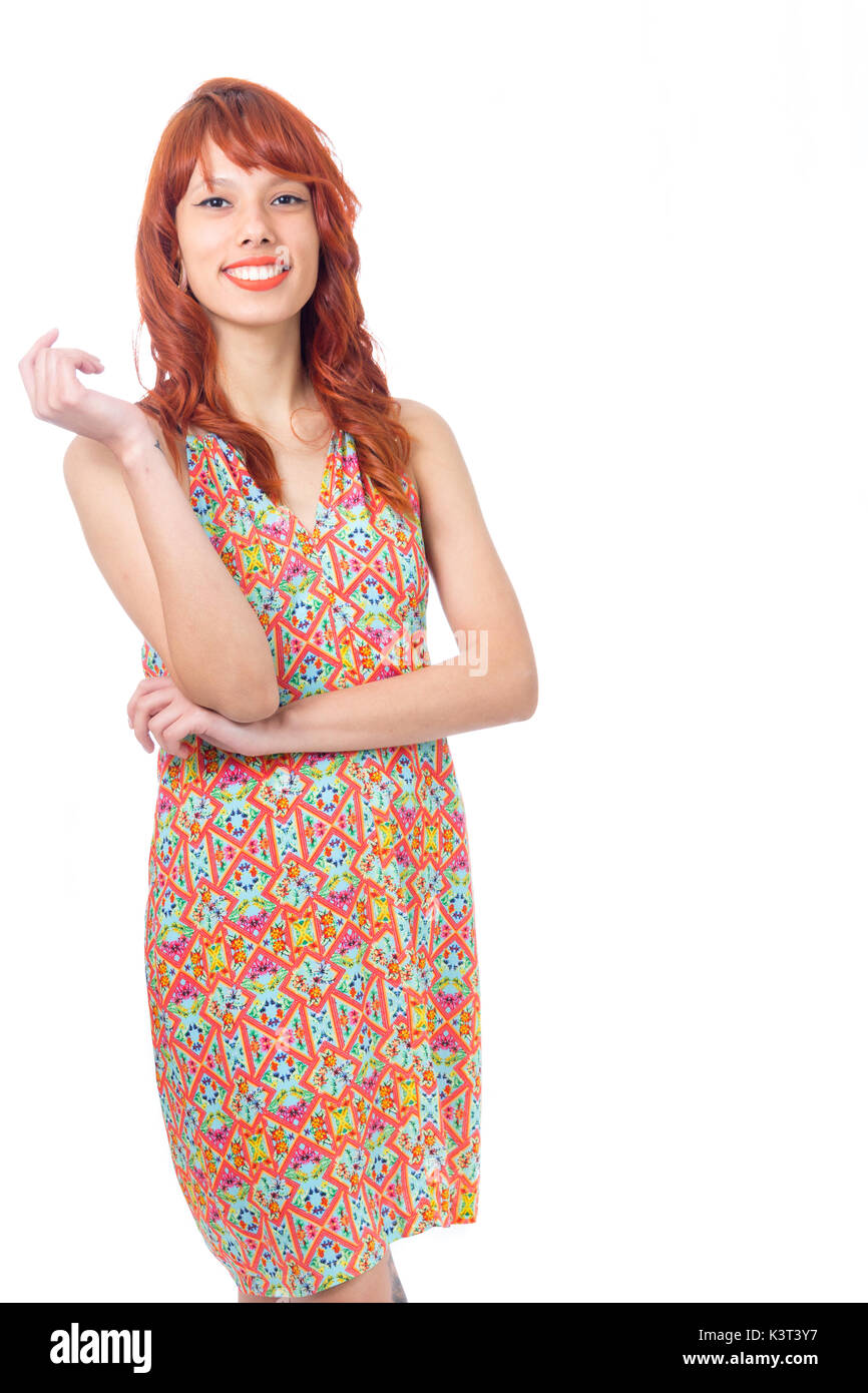 Redhead woman is wearing a colorful summer dress. Fashion and style. Vacation and summer. - Stock Image