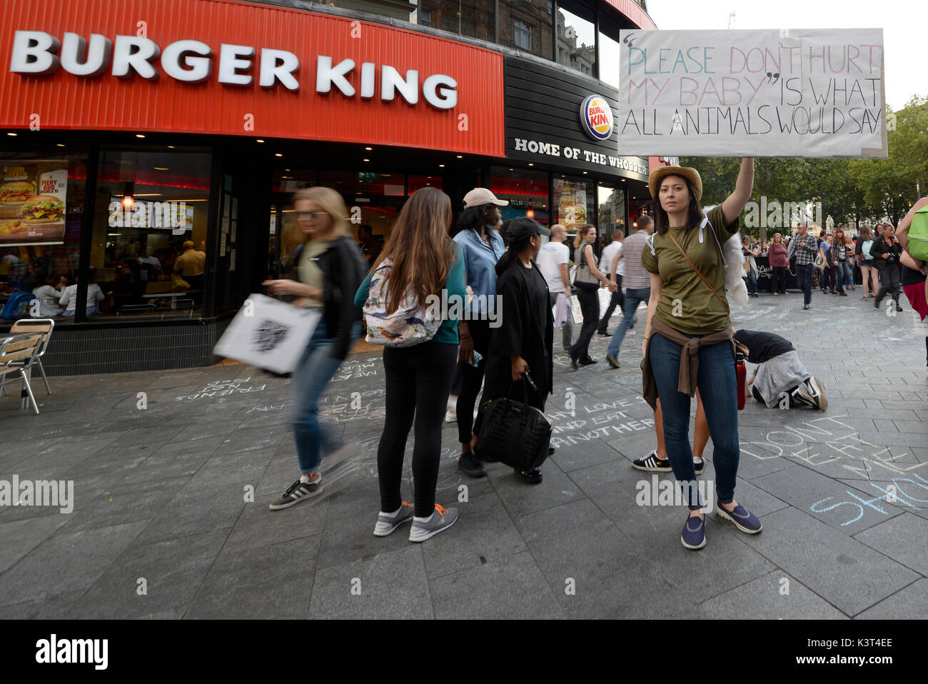 Jenna Goodwin animal rights protesters outside Burger King Leicester Square attempting to convert the public to become vegan in London. Space for copy - Stock Image