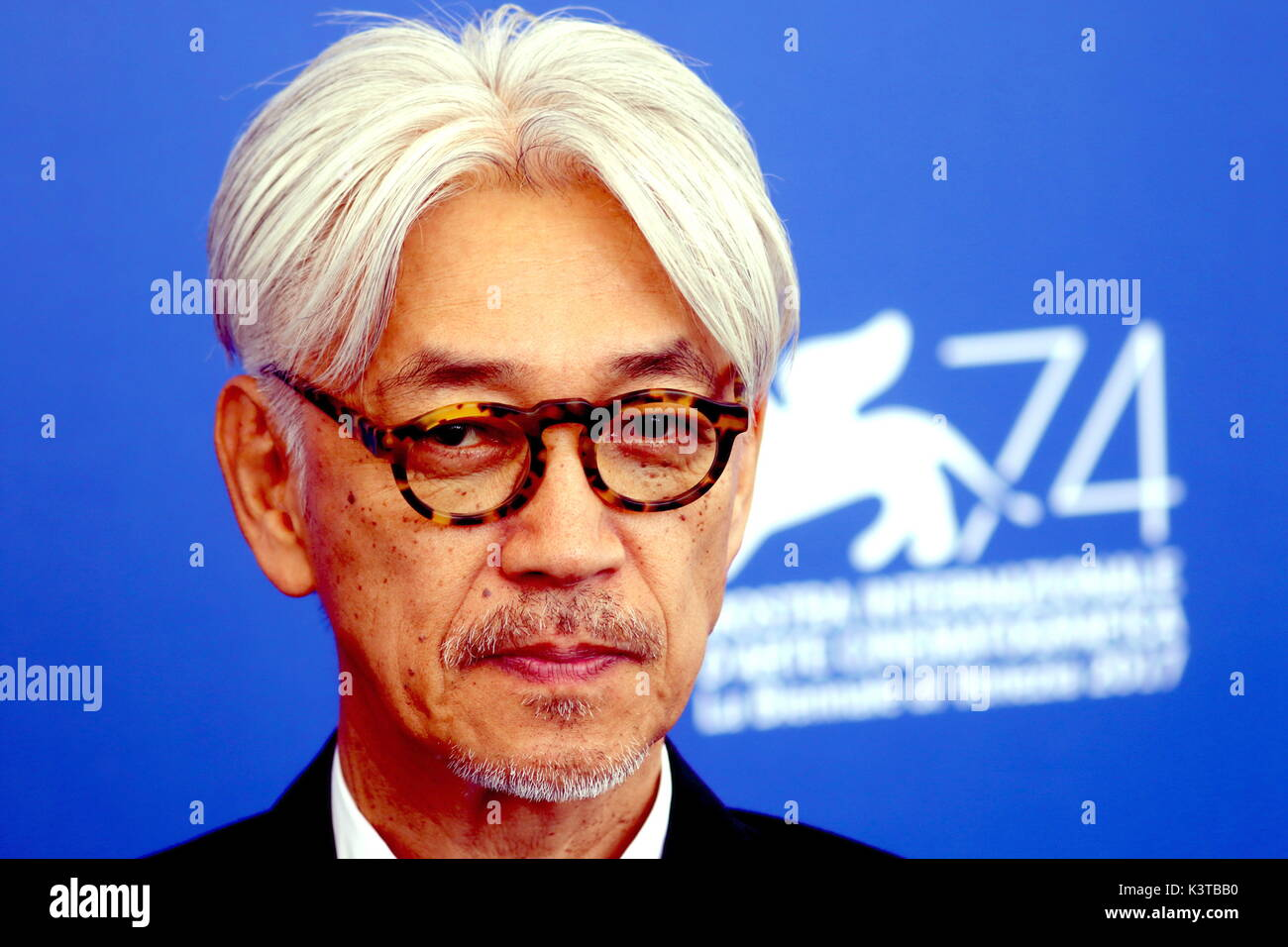 Venice, Italy. 3rd Sep, 2017.Japanese musician Ryuichi Sakamoto attends the photocall of the movie 'Ryuichi Sakamoto : Coda' during the 74th Venice International Film Festival at Lido of Venice on 3th September, 2017. Credit: Andrea Spinelli/Alamy Live News - Stock Image