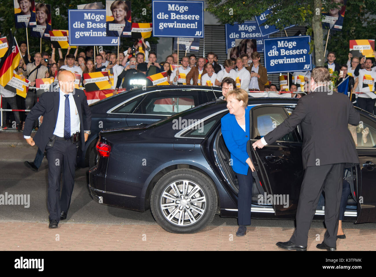 Berlin, Germany. 03rd Sep, 2017. Dr. Angela Merkel, arriving at, In the background some fans and members of CDU - JU, TV - election - duel, Dr. Angela Merkel - CDU vs. Martin Schulz - SPD, GER, 03.09.2017, Foto: Uwe Koch/fotobasis.de Credit: Uwe Koch/Alamy Live News - Stock Image