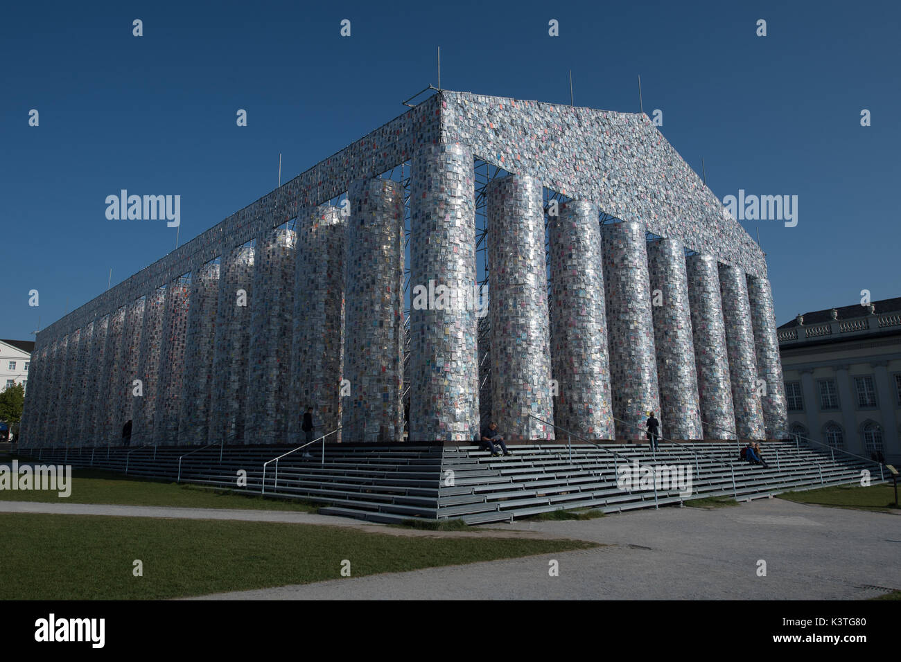 Forbidden books wrapped in plastic hang on the finalized documenta artwork 'The Parthenon of Books' in Kassel, Germany, 4 September 2017. The reconstruction of the Parthenon temple by Argentinian artist Marta Minujin is one of the biggest projects of the documenta. The documenta 14 in Kassel continues until 17 September 2017. Photo: Swen Pförtner/dpa - Stock Image
