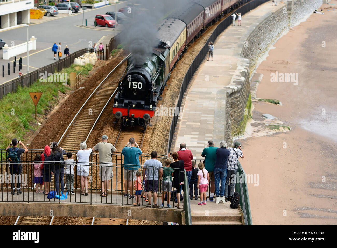 People watching the Royal Duchy steam train passing through Dawlish, hauled by LMS 4-6-0 No 46100 'Royal Scot'. - Stock Image