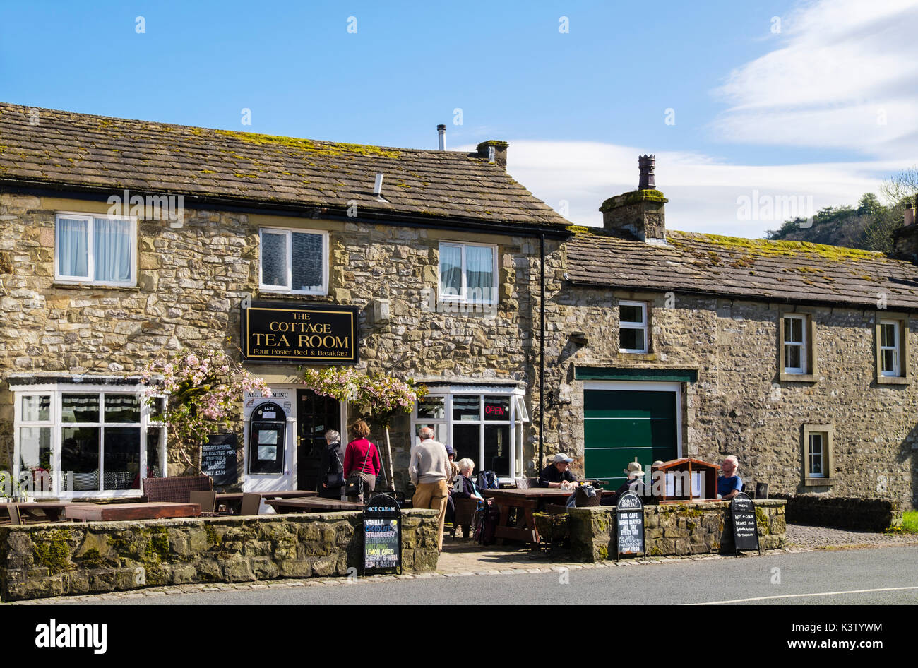 People entering The Cottage Tea Room cafe in Kettlewell, Upper Wharfedale, Yorkshire Dales National Park, North Yorkshire, England, UK, Britain - Stock Image