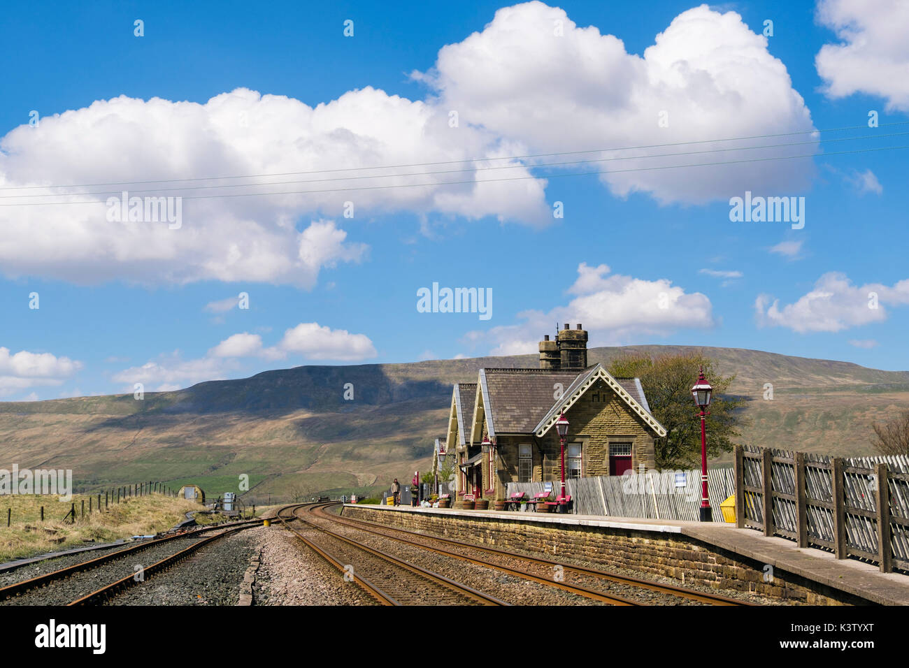 Ribblehead station on Settle to Carlise railway line with Whernside hill beyond. Ribblehead Yorkshire Dales National Park North Yorkshire England UK - Stock Image