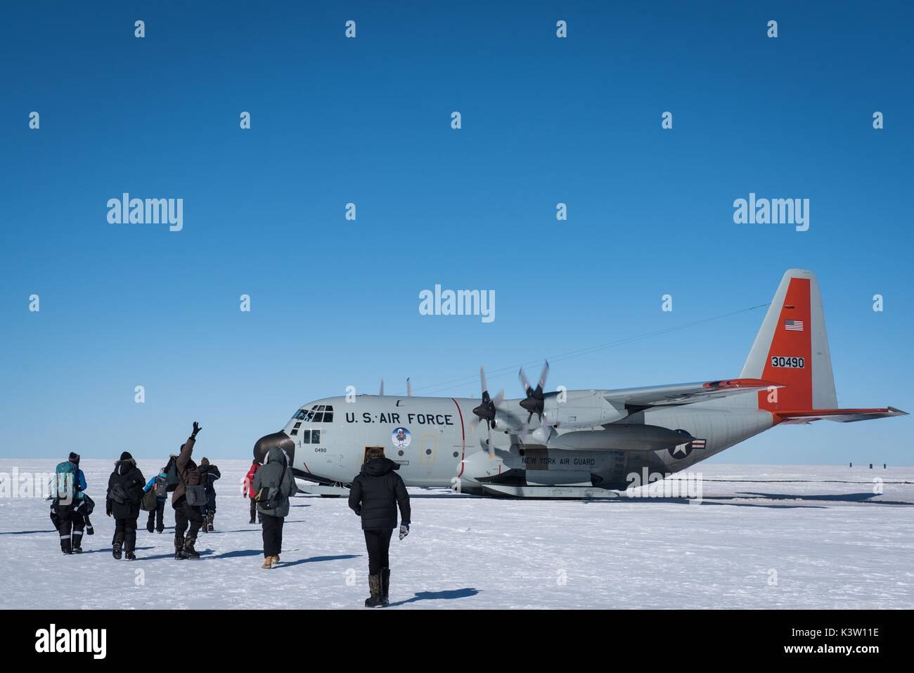Scientists board a U.S. Air Force LC-130 Hercules aircraft at the East Greenland Ice Core Project underground station July 29, 2017 in Kangerlussuaq, Greenland.  (photo by Greg C. Biondo  via Planetpix) - Stock Image