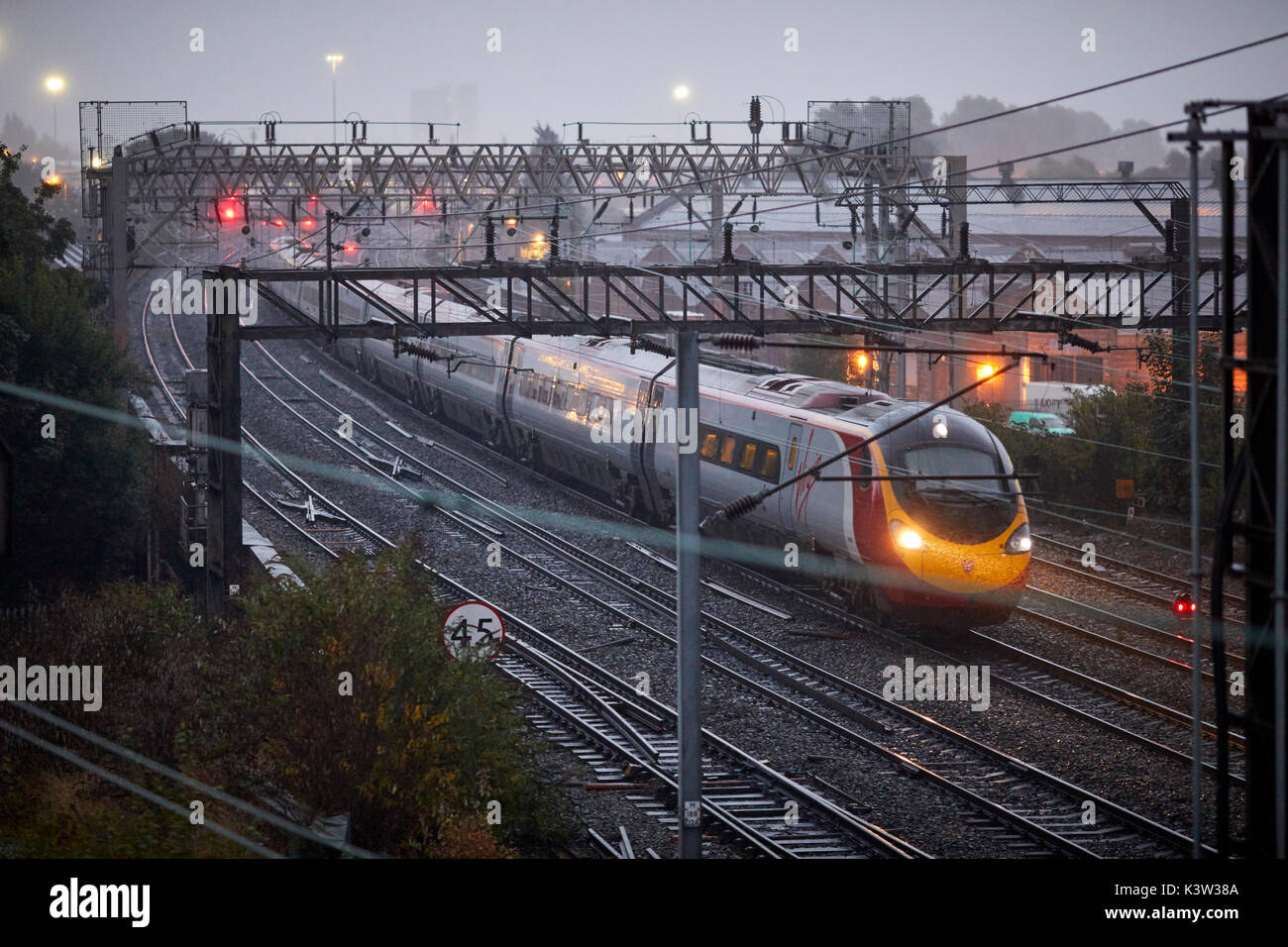 From London Virgin Alstom Class 390 Pendolino at Ardwick leading to Manchester Piccadilly station on the  West Coast Stock Photo