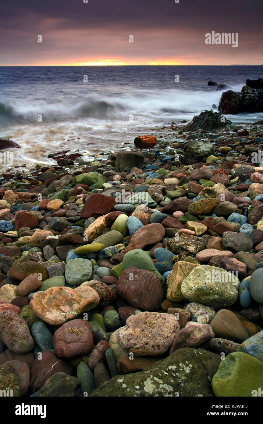 A view of the colourful rocks of Freshwater West, Pembrokeshire, UK - Stock Image