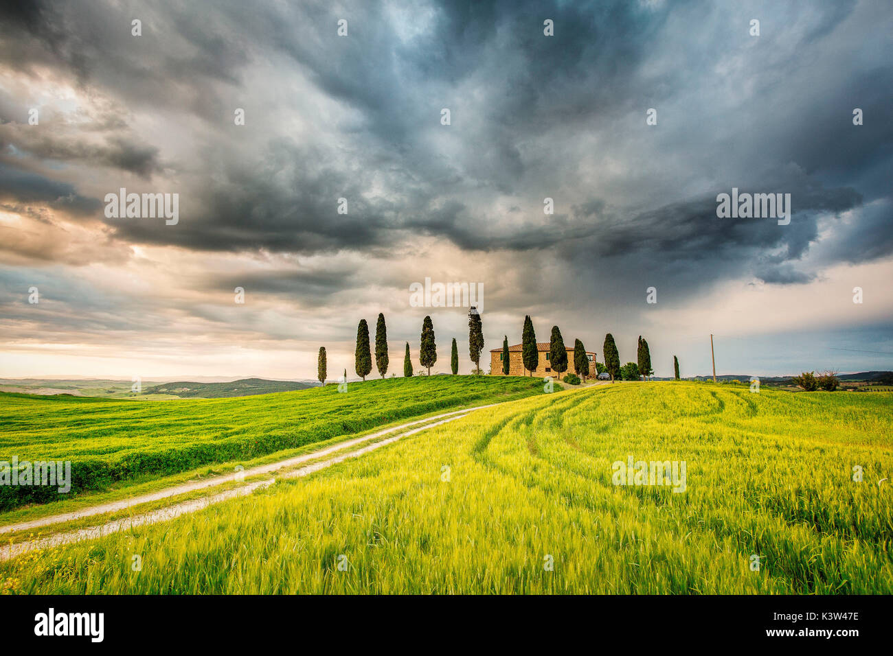 Val Du0027Orcia, Tuscany, Italy. A Lonely Farmhouse With Cypress Trees Standing