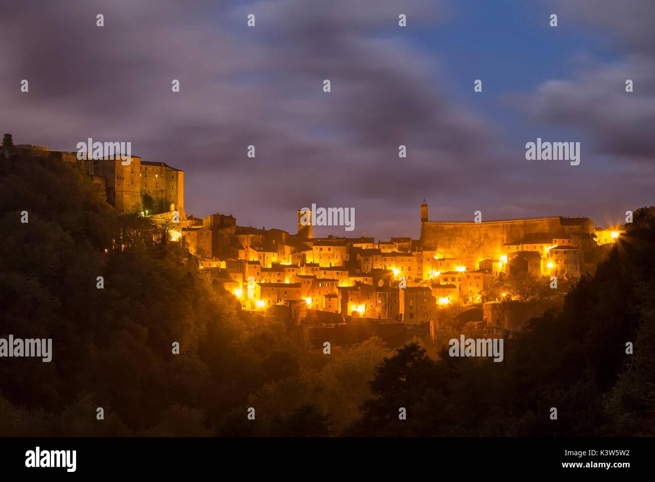 Village of Sorano at night.Sorano, Grosseto province, Tuscany, Italy, Europe - Stock Image