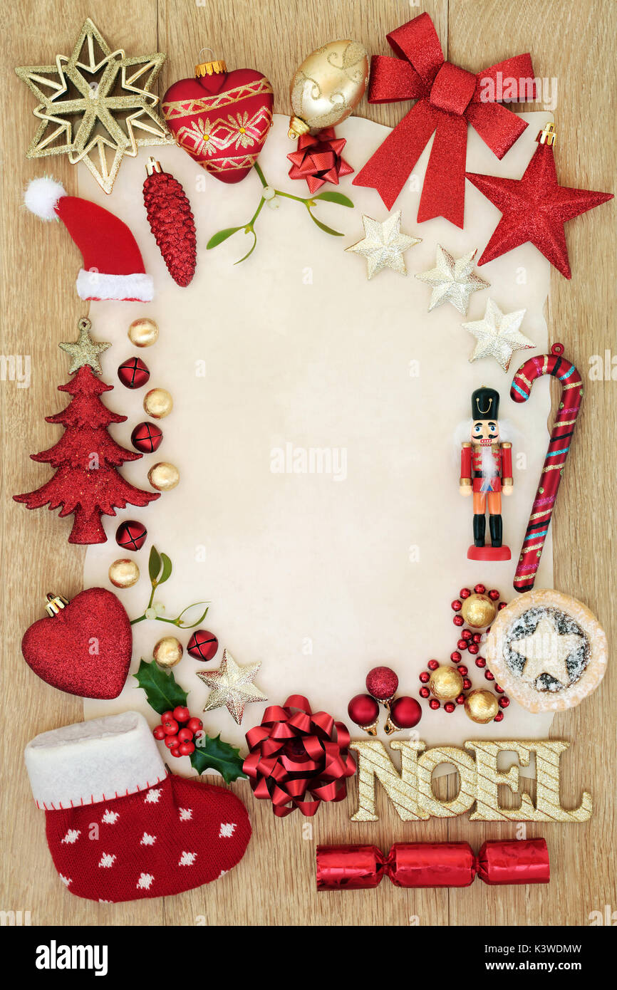 christmas background border with bauble decorations gold noel sign mince pie foil wrapped chocolates holly and mistletoe on parchment paper oak w