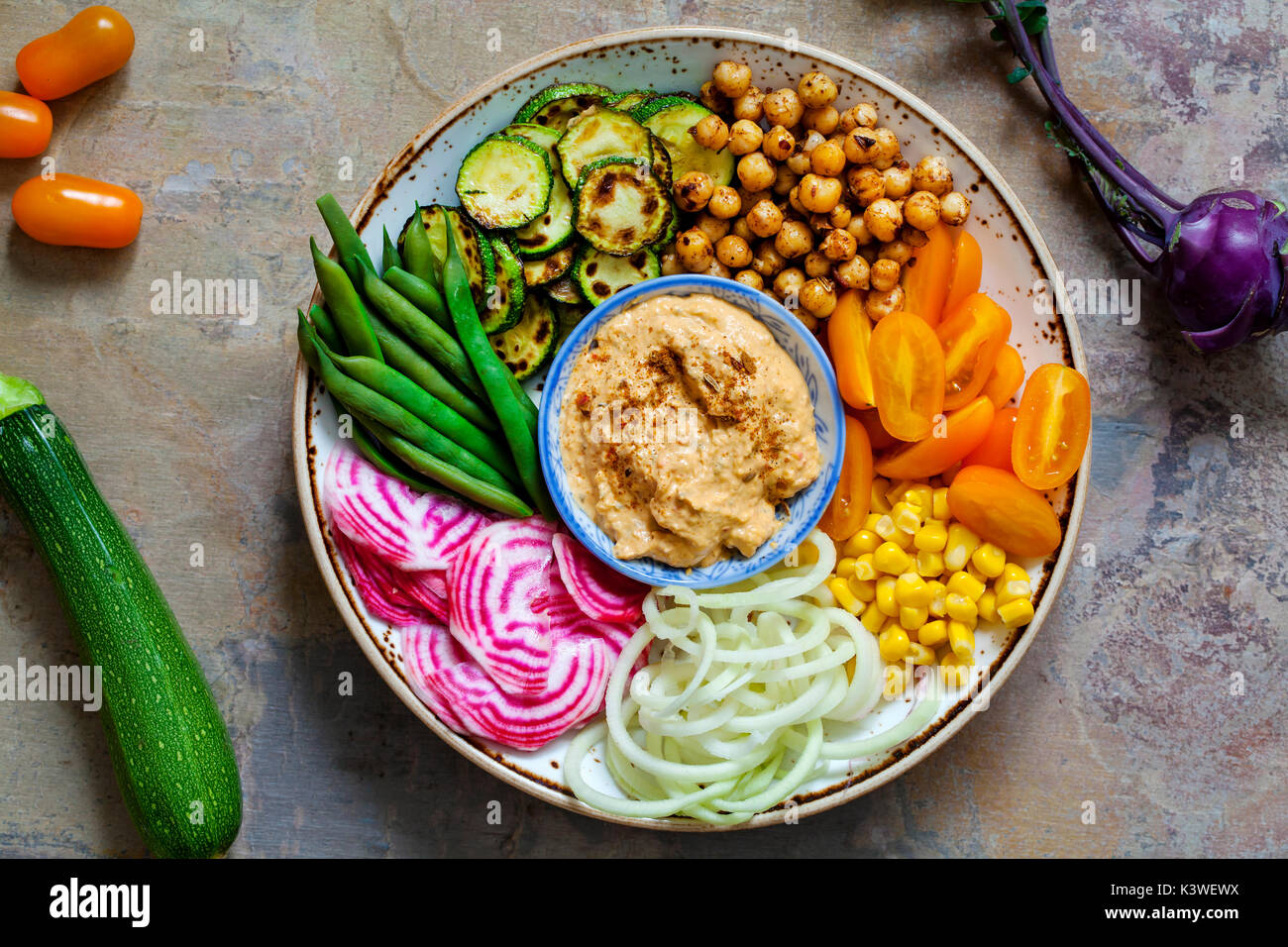 Vegan Buddha bowl with mixed vegetables - Stock Image