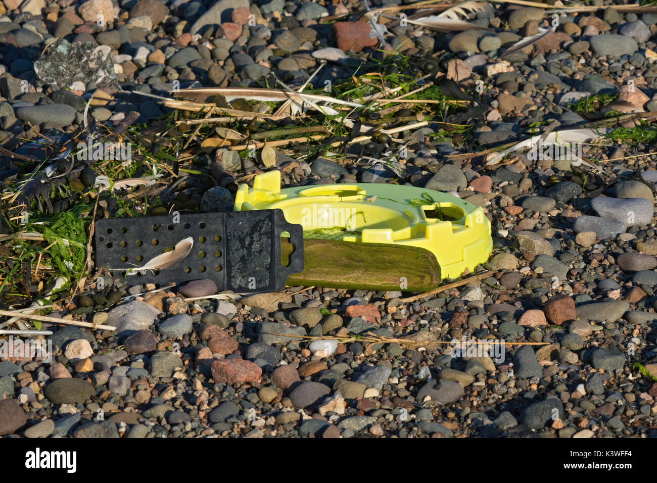 Plastic rubbish washed up on beach in Lancashire - Stock Image