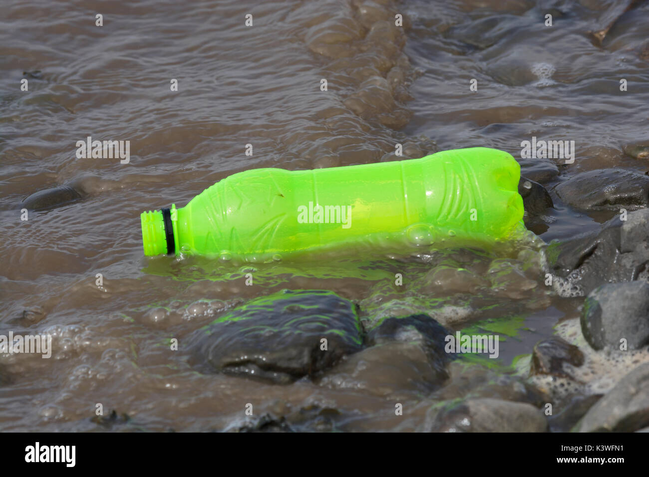 Plastic bottle washed up on beach in Lancashire - Stock Image