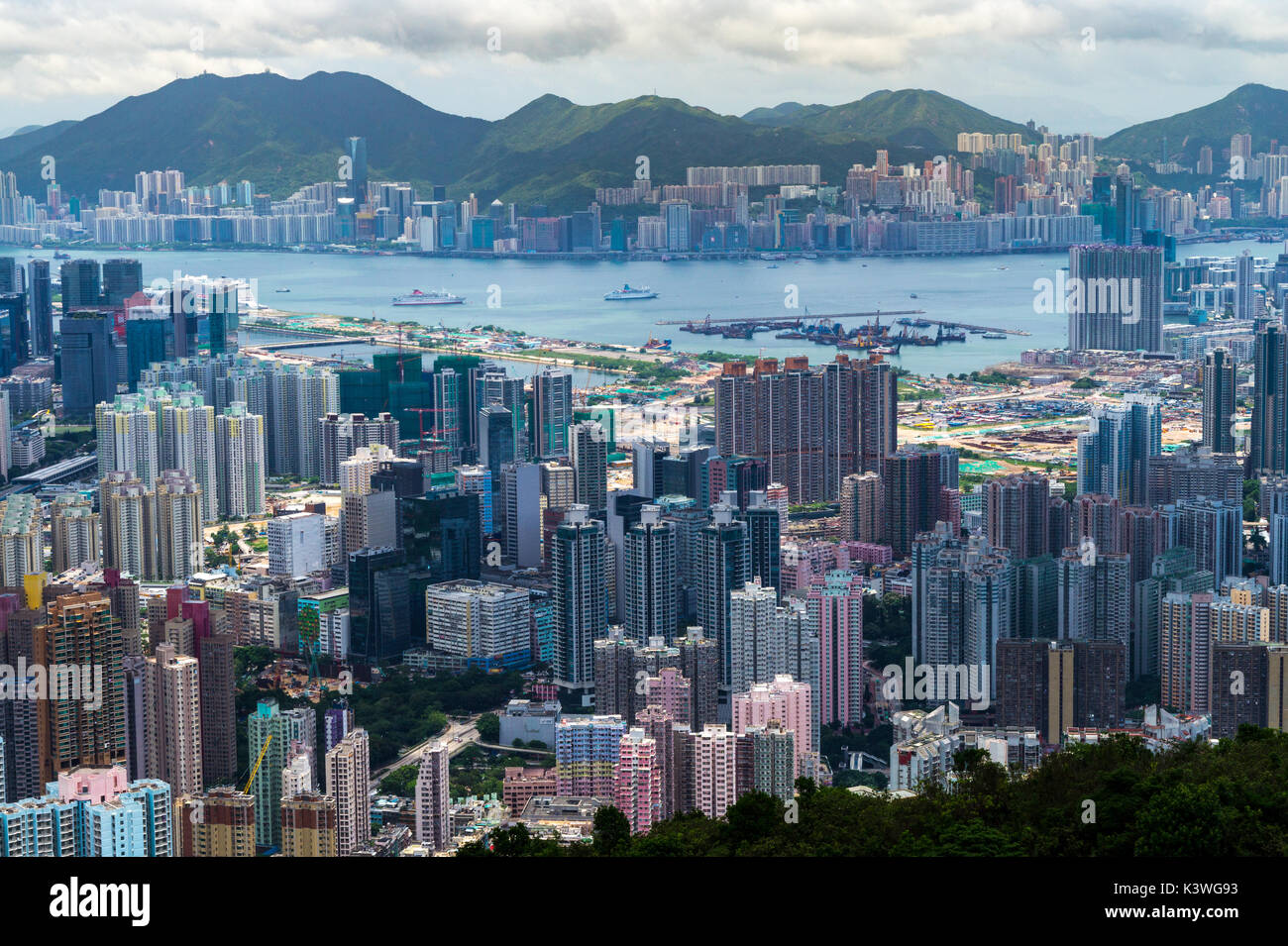 Population density and urbanization, indicated by dense built housing estates in Hong Kong SAR - Stock Image