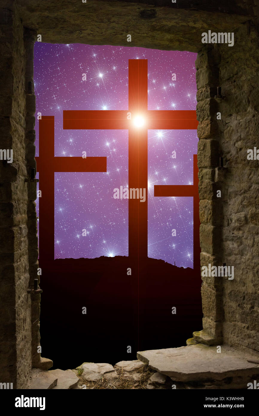 Jesus' cross on the Calvary hill with sky filled by twinkling sparkling stars as a  symbol of Christianity end Easter concept wisible through ancient  - Stock Image