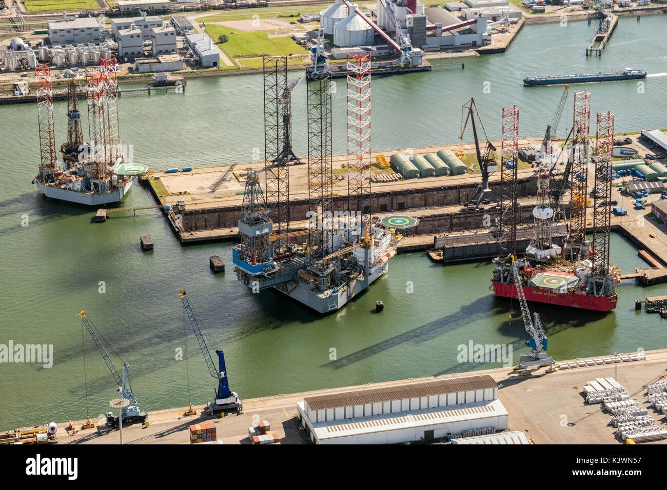 ROTTERDAM, THE NETHERLANDS - Rig platforms moored in the Port of Rotterdam. Stock Photo