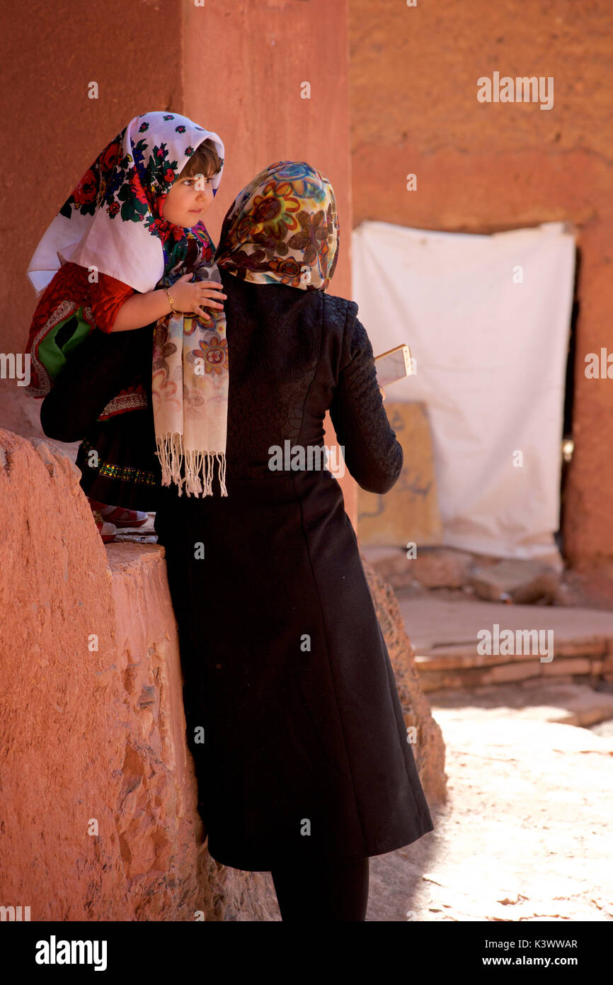 Iranian mother and daughter visiting Abyaneh village, Barzrud Rural District, Isfahan Province, Iran - Stock Image