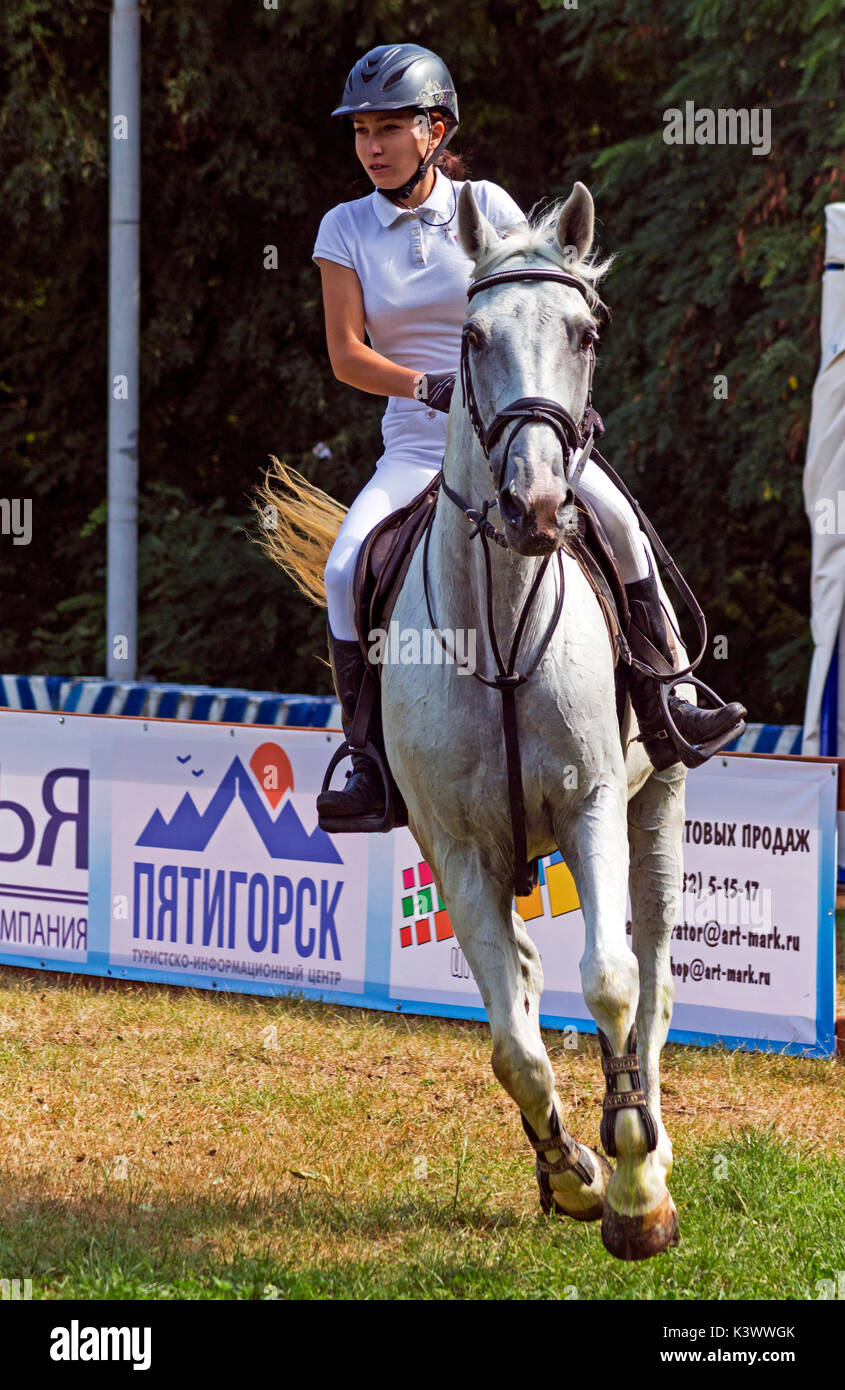 PYATIGORSK,RUSSIA - SEPTEMBER 02,2017:Competitions in equestrian sport for the cup of the Pyatigorsk city head.A young rider on a gray horse prepares  - Stock Image