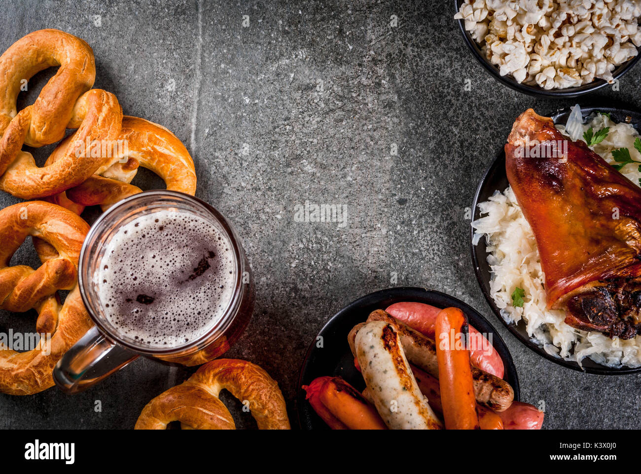 Selection of traditional german food oktoberfest beer baked pork selection of traditional german food oktoberfest beer baked pork shank popcorn assortment of different sausages homemade bretzels on a black sto forumfinder Choice Image
