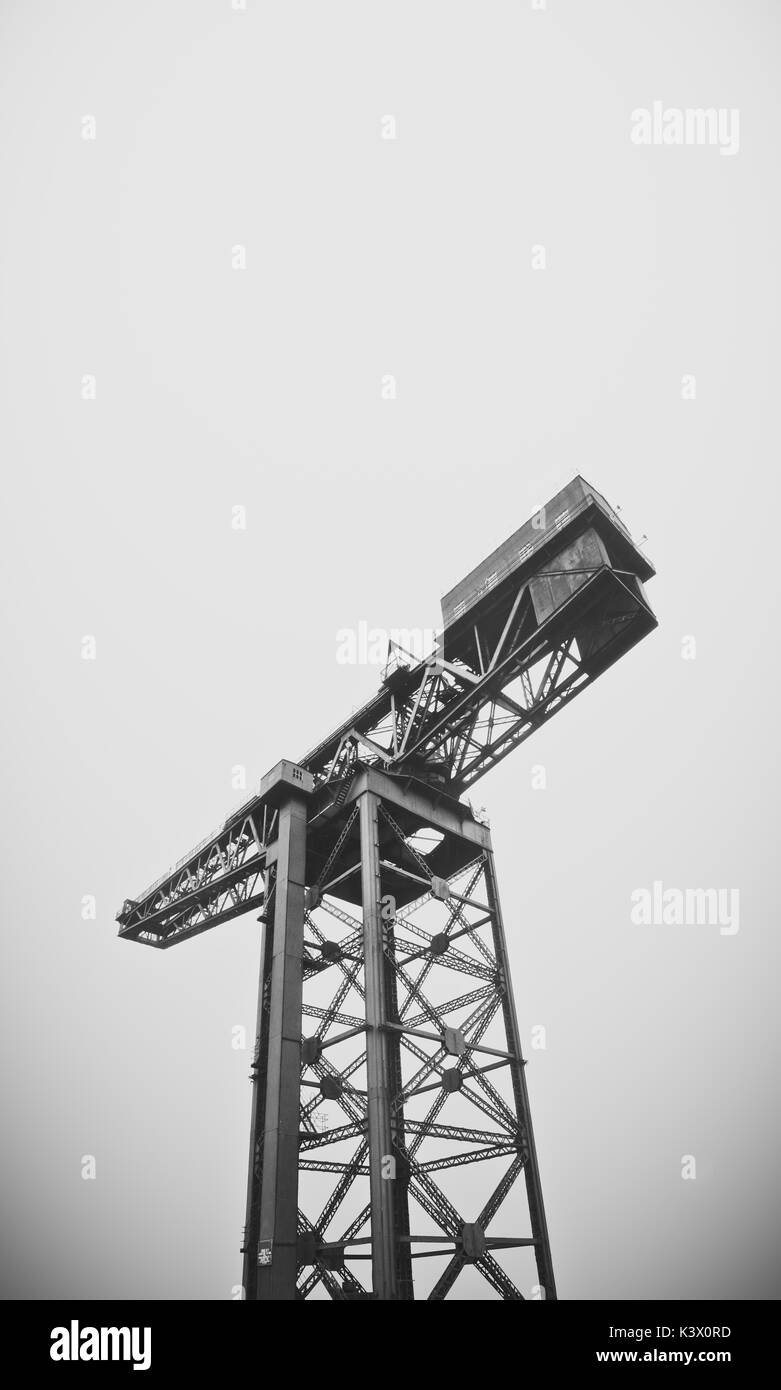 Industrial Shipbuilding Crane Against A Grey Sky With Copy Space - Stock Image