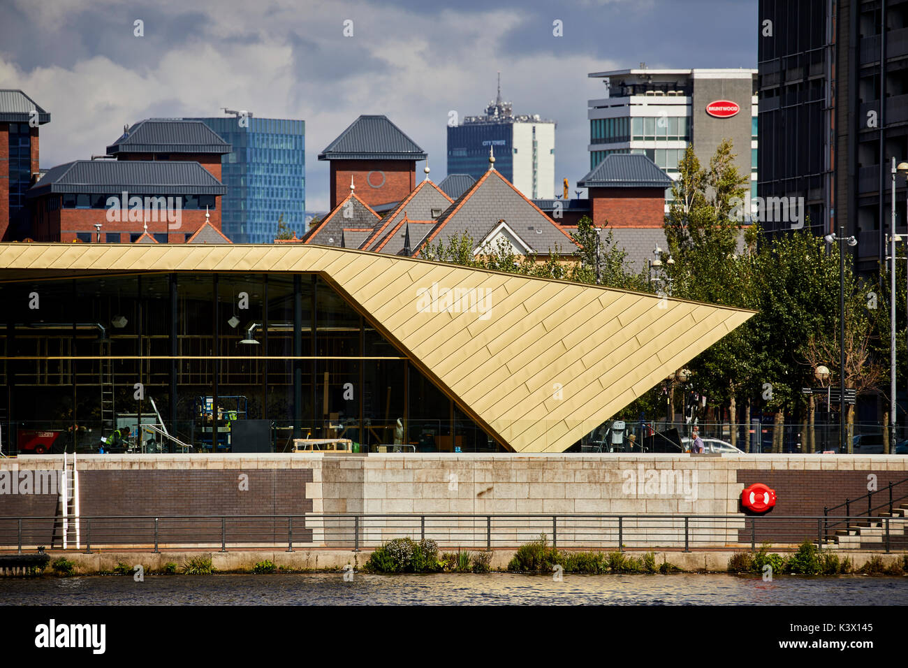 Regeneration docks area MediaCityUk at Salford Quays Gtr Manchester, gold modern architecture The Alchemist Bar Stock Photo