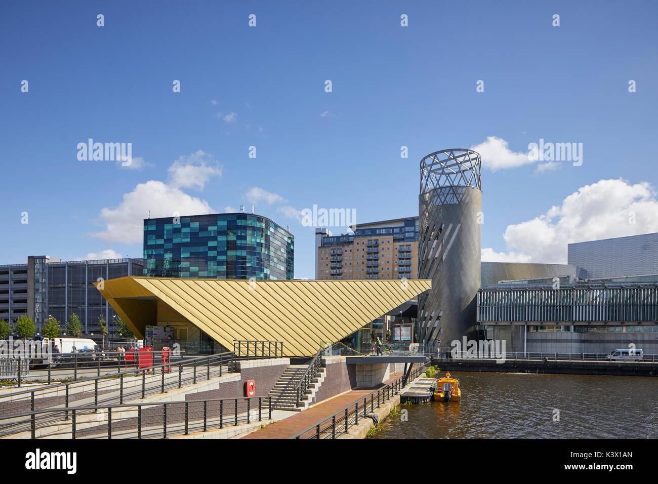 Regeneration docks area MediaCityUk at Salford Quays Gtr Manchester, gold modern architecture The Alchemist Bar Stock Photo