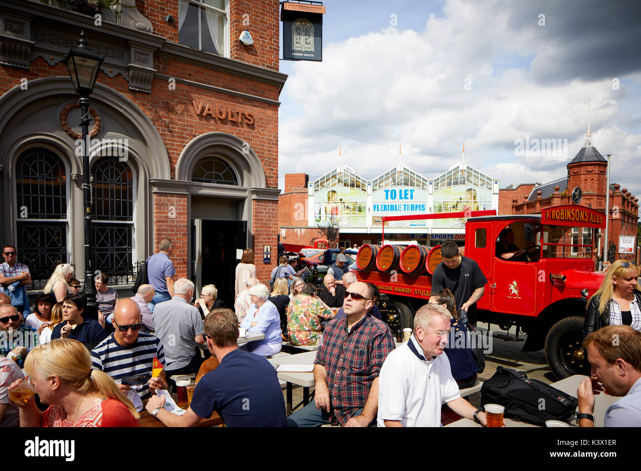 Landmark Stockport Town Centre Cheshire in gtr Manchester St Historic Robinsons Brewery Bakers Vault on the Market Brow with vintage car show - Stock Image