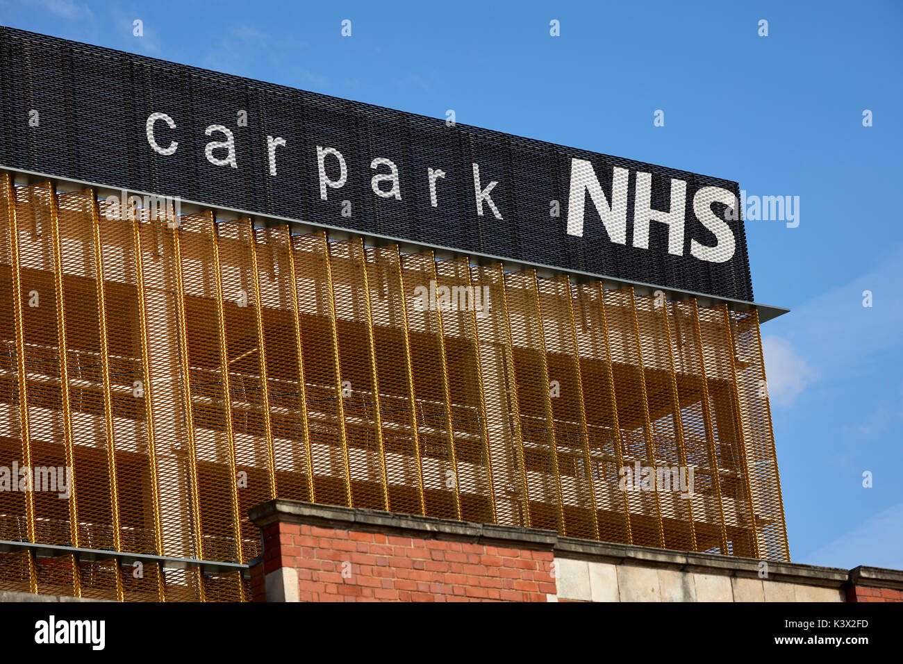 Modern designed carpark Central Manchester University Hospitals NHS Foundation Trust Wilmslow Road South Manchester - Stock Image