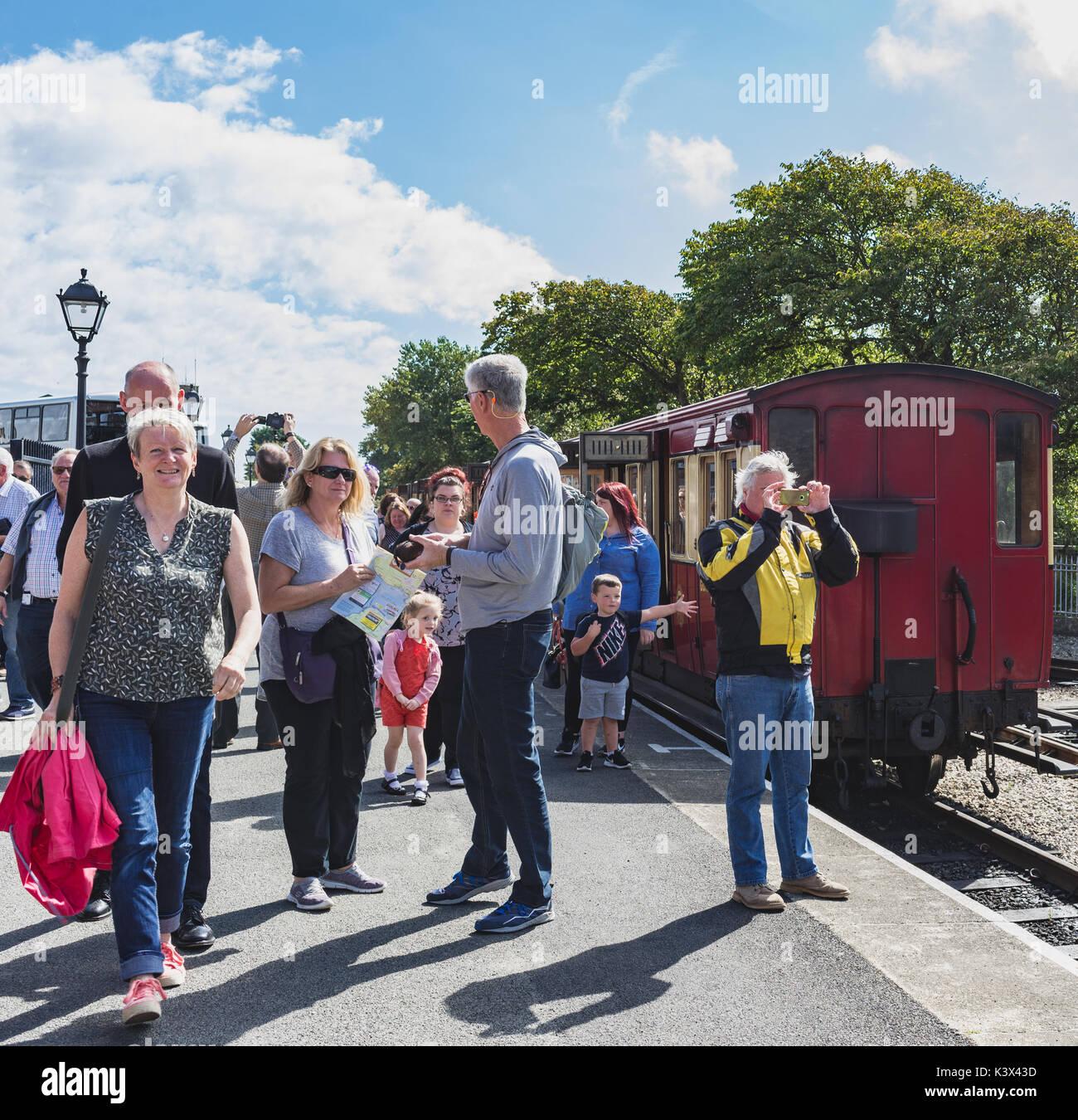 People on railway platform at Port Erin train station - Stock Image