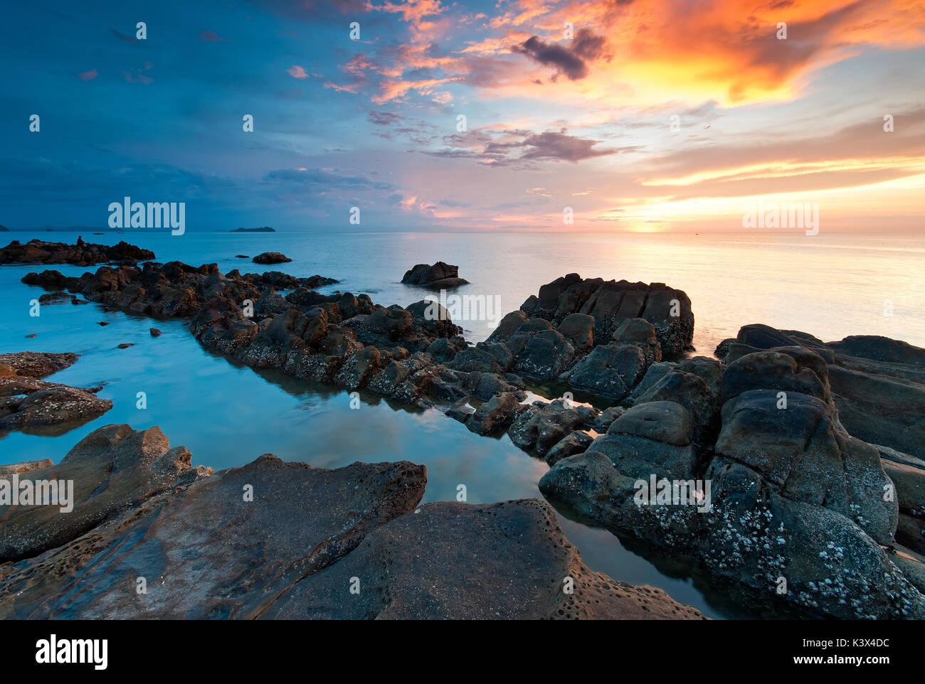 Beautiful sunset in Kota Kinabalu beach, Sabah Borneo, Malaysia. - Stock Image