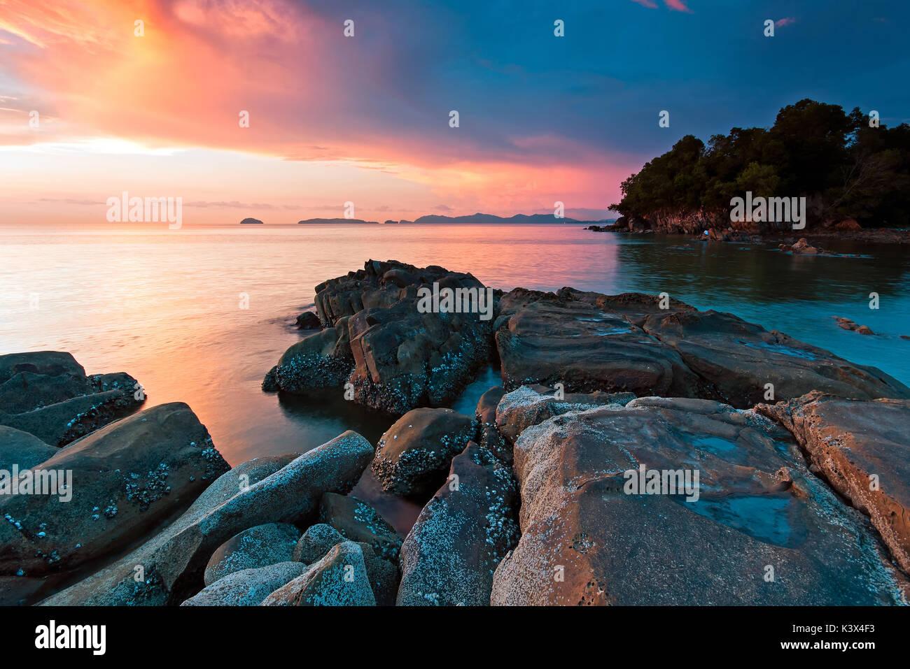 Dramatic sky during sunset in Kota Kinabalu beach, Tanjung Lipat in Sabah Borneo, Malaysia. - Stock Image