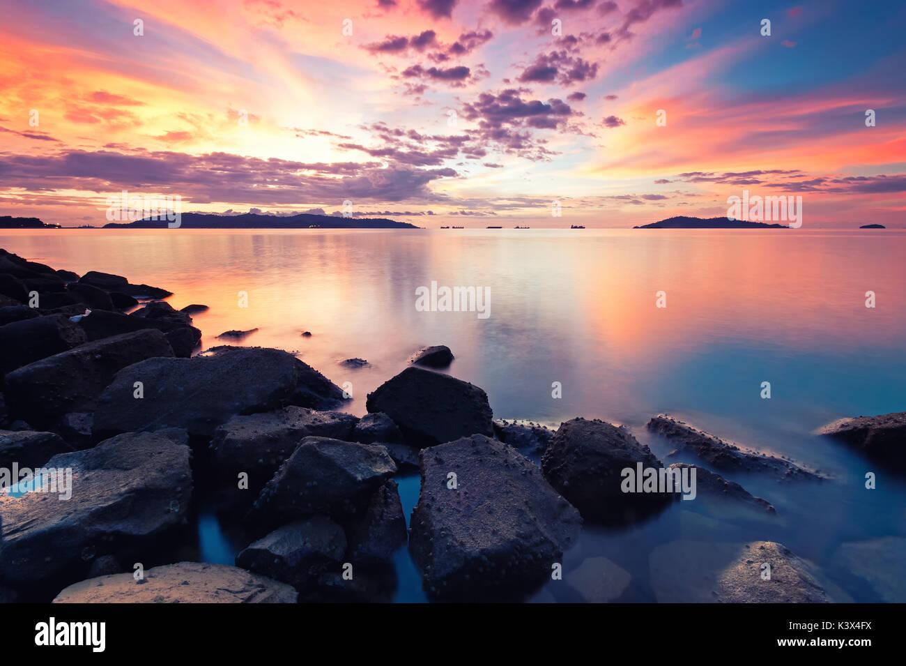 Stunning sunset in Kota Kinabalu beach, Tanjung Lipat in Sabah Borneo, Malaysia. - Stock Image